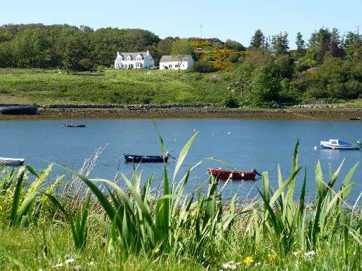 View of Ceomara Cottages from across Badachro Bay
