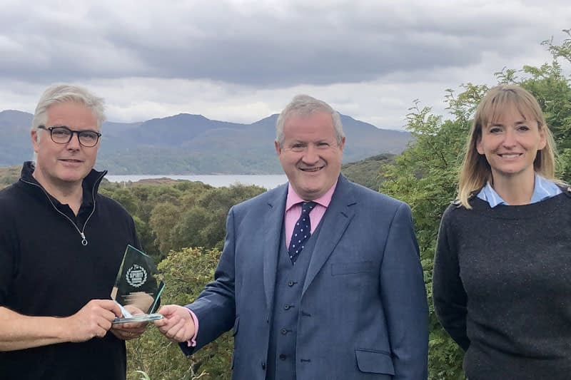 Gordon & Vanessa receive their award from Iain Blackford MP